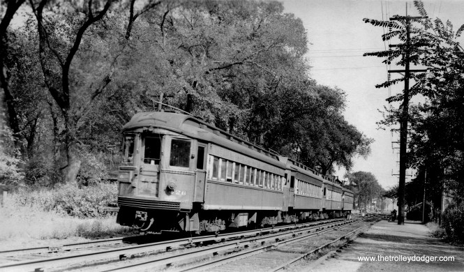 Chicago Aurora & Elgin car 426 heads up a westbound train in September 1946. The location is not identified, other than being in Maywood. My guess is this is 5th Avenue looking east, and you can catch a glimpse of the station at right. This is prior to the installation of high-level platforms.