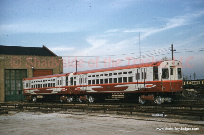 """This very nice picture shows two of the CTA's new single car units on November 25, 1960, and was taken by Robert E. Bruneau. These were given high-speed motors and """"circus wagon"""" colors for a time."""