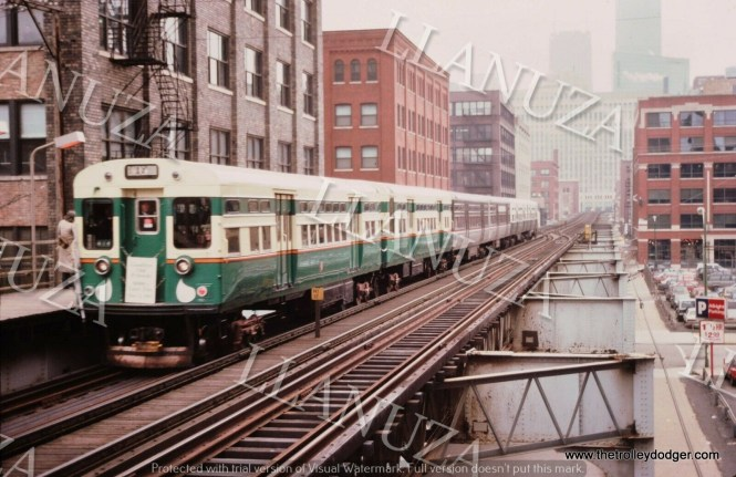 """This Mark Llanuza picture from December 1982 says it is a """"last run."""" I can't make out what the sign says, but at the very least, it's a six car CTA """"L"""" train, made up of three sets of 6000-series cars, each painted different colors."""