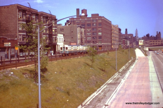 A two-car CTA traiin of 6000s is running on temporary trackage in Van Buren Street in May 1958. The following month, the Garfield Park line was replaced with the new Congress rapid transit line. (J. W. Vigrass Photo)