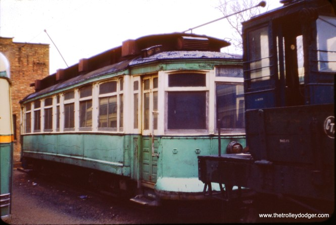 "I am not sure what number CTA car this is, in this 1954 photo, or why it is painted green instead of red. (J. W. Vigrass Photo) Steve D. adds, ""Alan R. Lind scribed the last survivor of the 2501-2625 series, which is what this car is, was 2605. It was sent to Devon Station 1948, and scrapped 1954. Somewhere during this span, it somehow got a Mercury Green paint job. But I am certain this is the unknown car."" Don Ross notes, ""2605 was built by St Louis Car Co in 1901. It was stored at Devon Barn in 1948 and scrapped there in 1954."""