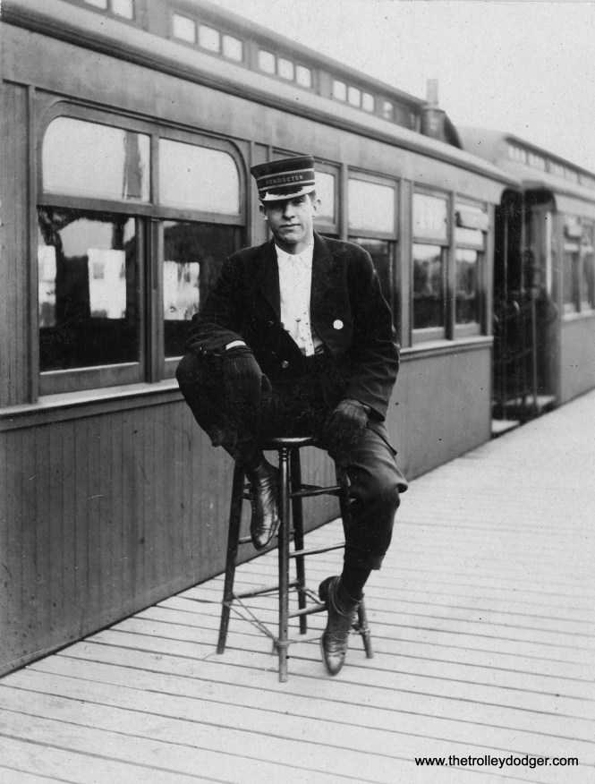 "A Met ""L"" conductor, possibly circa 1910. Notice how the stool he is sitting on has been repaired using some twine. This may possibly have been taken at Logan Square."