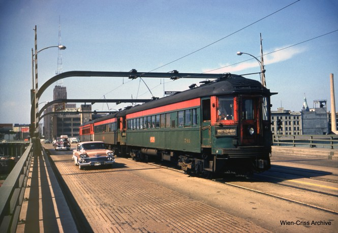 NSL 741 creeps south along the old 6th Street viaduct in Milwaukee, next to a 1958 Chevy. (Wien-Criss Archive)