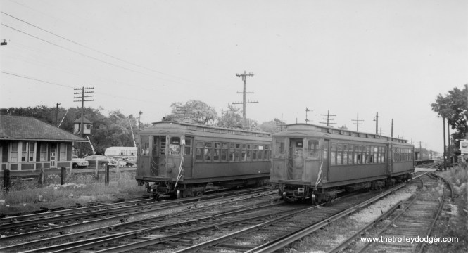 Met cars passing each other at DesPlaines Avenue in Forest Park, possibly circa 1952. There is a bus visible, which could be the CTA #17, which replaced the Westchester branch in December 1951. But it looks like this predates the rearrangement of this area which took place in 1953, when the Chicago Aurora and Elgin cut back service to Forest Park.