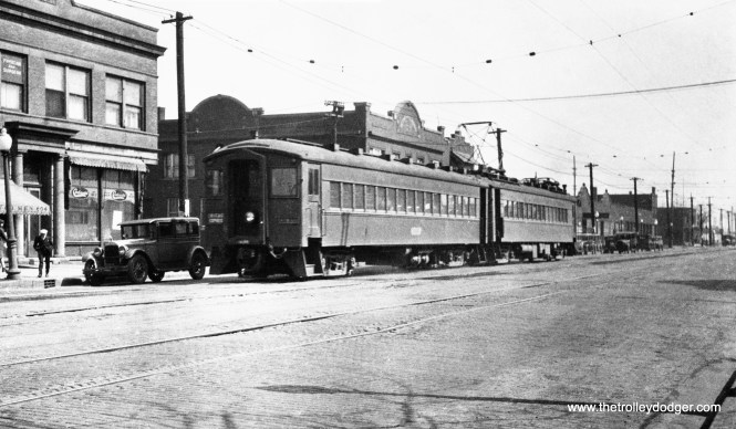 Here, we see the Chicago, South Shore & South Bend interurban (commonly known as the South Shore Line) running down the street in East Chicago, Indiana, in the late 1920s.