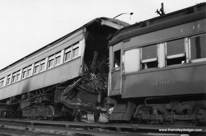 "Although the Chicago Aurora & Elgin had an admirable safety record, I am sure, sometimes there were accidents. Here, we see cars 400 and 318 have collided. 318 must have been repaired, as it did survive the interurban, at least for a while. Don's Rail Photos notes: ""318 was built by Jewett Car Co in 1914. It had steel sheating and was modernized in 1944. It was sold to Wisconsin Electric Raiway Historical Society in 1962. It was wrecked in transit and the parts were sold to IRM to restore 321."" This picture was taken at Lockwood Yard, just west of Laramie, in June 1945. Not sure if the modernization was actually done prior to the crash, or as a result of it. Dates for these things are sometimes approximate. (Don Mac Bean Photo)"