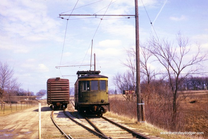 What is known today as the East Troy Electric Railroad survived to the present day due to its continued use as an electric freight line, as this scene from April 16, 1965 shows. Once part of the TMER&L interurban network, there was passenger service between East Troy and Milwaukee from 1907 to 1939. The railroad continued to operated freight for another ten years after that, and starting in 1950, the interchange line was owned and operated by East Troy. Museum operations began to be phased in as early as 1967. Here, we see line car M-15 at Mukwonago. This car is now at the Illinois Railway Museum.