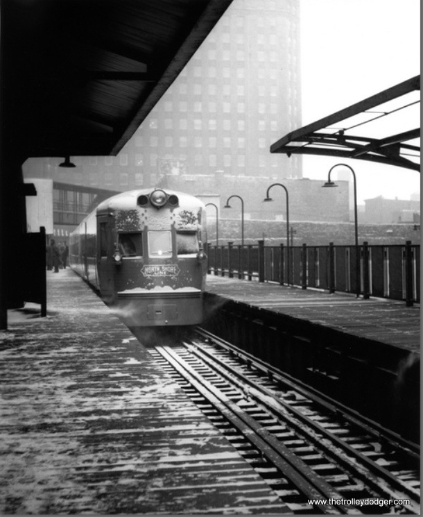 "On February 6, 1941, the North Shore Line ran some special trips to introduce its new, streamlined Electroliners. Here we see one of the two sets at the North Water Terminal on Chicago's ""L"" system."