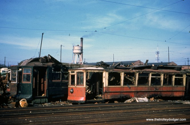 "Scrapped streetcars, including work car AA57, at South Shops. Don's Rail Photos: ""AA57, salt car, was built by St Louis Car Co in 1903 as CUTCo 4835. It was renumbered 1306 in 1913 and became CSL 1306 in 1914. It was rebuilt as salt car in January 1934 and renumbered AA57 on April 15, 1948. It was retired on December 14, 1956."""