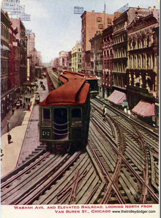 "This must have been a popular postcard, as it turns up a lot. This example was never mailed and is in excellent condition. It does show the bi-directional, left-hand running Loop, though, so it must date to before 1913. The Met car at left is heading north, away from us. The train at right is heading towards us. I suspect it is a Northwestern ""L"" car, about to head west on Van Buren. There were no transfer bridges at Loop stations until 1913. The view looks north at Wabash and Van Buren from Tower 12."