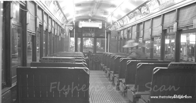 The interior of New Orleans Public Service 924 on April 19, 1958, as photographed by Bob Selle. Note the ugly signs, evidence of the racial segregation of the time.