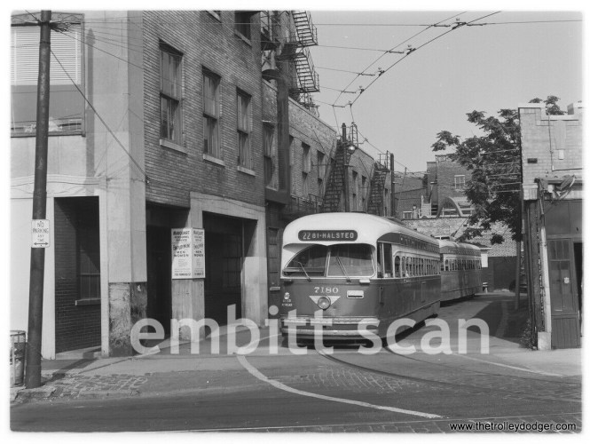CTA 7180 is about to depart the terminal loop just south of Howard Street on Clark. Where the PCCs are is now a restaurant patio area.