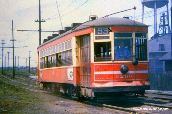 "CTA 6209 on Route 93 by the Belt Railway, between Kenwood and Harper on August 13, 1948. M.E. notes, ""The destination sign begins with ""89 Avenue"", so this car is running east. Lind's book confirms the eastern terminus was at 89th and Avenue O."""