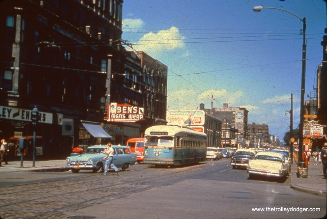 "CTA 4405 on Clark Street at Chicago Avenue. Bill Barber writes, ""I believe this photo in your Oct 12th email is misdated. The blue station wagon in front of the PCC is a 1956 Plymouth and the yellow and white car immediately behind the PCC is a 1955 Chevy. Considering that new automobile models were introduced, at that time, in September of the year before the actual model year, the earliest that this photo could be is late 1955."""