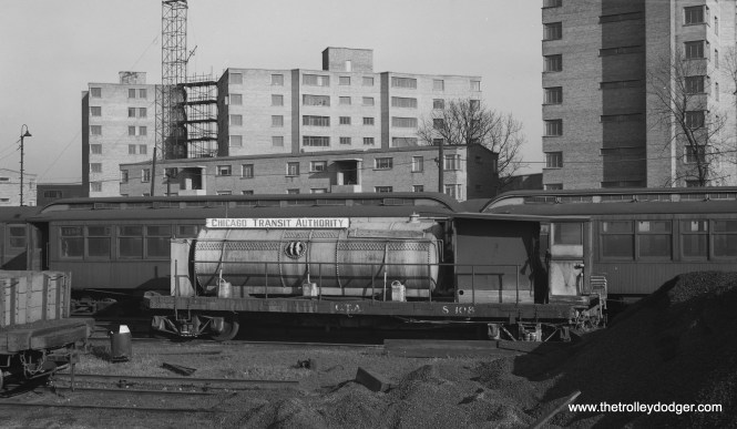"""CTA subway wash car S-108 is in front of trailer 1199 at the """"L"""" supply yards at 63rd and South Park on January 9, 1954. (Robert Selle Photo)"""