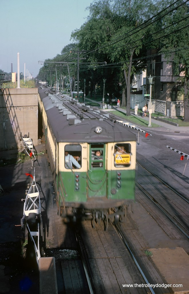 CTA Westbound Lake Street L approaching the Oak Park Ave. station while crossing the Euclid Ave. grade crossing in Oak Park, IL on August 14, 1962