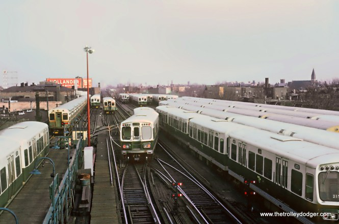 """CTA Logan Square Terminal and Yards Before the Kennedy Extension, 5 Photos The Logan Square station served the CTA as the terminal of the Milwaukee (Ave.) """"L"""" until February 1, 1970 when the Kennedy Extension to Jefferson Park (and later to O'Hare) opened. But on May 30, 1966, a new all-electric interlocking was placed in service at Logan Square tower. Roger Puta and Rick Burn had just visited Logan Square the month before and took these photos. These are Roger Puta's photos except for Photo 2. 4. A Douglas Park bound B train crossing over just outside Logan Square terminal while Congress-Milwaukee A train waits. Taken from unfinished tower. Sean Hunnicutt adds, """"2153-54 still on break at the right."""""""