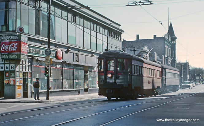CNS&M Train 415 starting to move on W. National Ave. on S. 6th St. in Milwaukee, WI on October 12, 1962