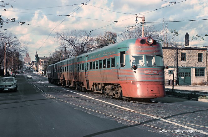 An Electroliner on the Milwaukee Streets -- 4 Photos I don't know how Roger Puta did it, but he photographed the same northbound Electroliner both on 5th and 6th Streets on October 21, 1962 only a couple blocks apart. Here are his captions. CNS&M Train 805, The Electroliner on S. 6th St. between W. Washington Ave. and Scott Ave. [Love the marked lights!]