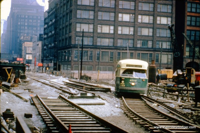 CTA PCC 4113, a product of the Pullman company, heads west of a shoo-fly at Madison and Wacker Drive on March 30, 1950. This was during construction of Lower Wacker Drive, which began in 1949 and moved south at the rate of about one block per year.