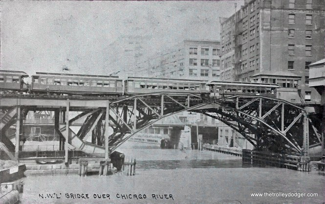 "Although this old real photo postcard identifies this as the ""N. W. ""L"","" this is actually the Met crossing the Chicago River over two side-by-side bridges. According to Daniel Adams, this picture cannot have been taken after mid-1915, as swing bridge shown, on Jackson Boulevard, was replaced then. Once I receive the original of this in the mail, I will post a better version. Thanks to J. J. Sedelmaier for improving this one."