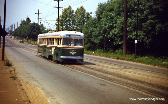 "Philadelphia Transportation Company Brilliner 2023 is north of Olney Avenue in May 1953, on a fantrip. Don's Rail Photos: ""2023 was built by Brill Car Co in April 1939, #23763-006. It was scrapped in August 1956."" Brill had been part of the group that developed the PCC car, but refused to pay patent royalties to other companies and dropped out, preferring to go their own way. It was a fatal mistake. By the time Brill introduced their PCC-lookalike, the Brilliner, in 1938, St. Louis Car Company had the PCC market sewed up, and Brill's was viewed as an inferior product in some ways. Hence, few were sold-- one to Philadelphia, one to Baltimore, 24 to Atlantic City, and 10 to Red Arrow. Brill made its last streetcar in 1941. (Wien-Criss Archive)"