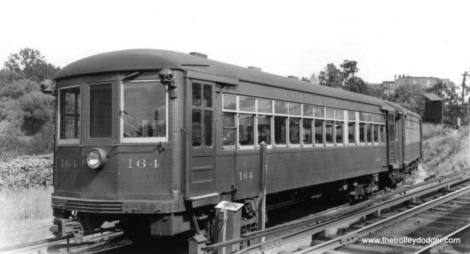 "Don's Rail Photos: ""64 was built by Brill in June 1927, #22529. It was rebuilt as 164 in 1931 and became PST 164 in 1948. It became SEPTA 164 in 1970 and became a de-icing car in 1989. It was sold to Travel Northern Allegheny in 1992 but never used. It was sold to East Troy Electric Ry in 1994 and rebuilt as ETE Ry 64 in 2000. It was sold to Electric City Trolley Museum and will be restored as P&W 164."" Here it is on September 28, 1958."