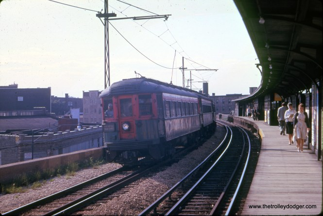 "North Shore Line car 413 heads up a southbound train under wire at the Loyola curve in June 1961, from a Kodachrome II slide. Kodachrome was first introduced in 1935, and it was reformulated in 1961 although still a very slow film at ISO 25. Prior to this it was ISO 10. Don's Rail Photos: ""413 was built as a trailer observation car by Cincinnati Car in June 1924, #2765. It was out of service in 1932. 413 was rebuilt on May 28, 1943."" (J. William Vigrass Photo)"