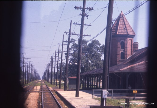 A view of the North Shore Line's massive station at Zion, taken from the front of a train in July 1960 by J. William Vigrass. The city insisted on a large station, as they were confidant that their religious community would quickly grow, which it did not. It was torn down soon after the line quit in 1963. This is from an Ektachrome slide that had not faded, suggesting that Kodak had fixed the dye fading problem by 1960.