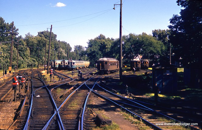 The CTA Linden Avenue Yard in Wilmette in July 1957. We see 5000s, 6000s, and wood cars present. To the left is where the North Shore Line's Shore Line Route continued north until the 1955 abandonment.