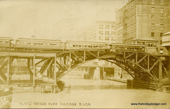 "I recently bought this real photo postcard, circa 1910. This is how it looked before restoration. I think the developer was not properly fixed when this was made 110 years ago, so the image has faded and may continue to do so in the future. This is the Metropolitan West Side Elevated crossing the Chicago River, not the Northwestern ""L"". But perhaps the ""N. W."" refers to Met trains that went to Humboldt Park and Logan Square."