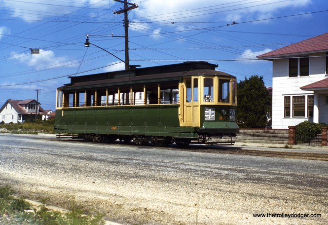 "All in all, I would have to say this is an amazing photograph. It shows Five Mile Beach Electric Railway car 22 on June 30, 1943, in the middle of World War II, and just two years before streetcars were abandoned in this coastal town (Wildwood) in New Jersey. From what I have read, the war and the resulting nightly blackouts negatively affected tourism and contributed to the demise of the streetcars here. With such an early abandonment, color photos of this operation are very rare, indeed, and the colors on this Red Border Kodachrome have held up quite well. A sign on the car advertises Marty Bohn and His Floor Show at the ""Nut Club."" The blackouts were not without reason, as German submarines were just offshore, and sometimes crew members would sneak ashore."