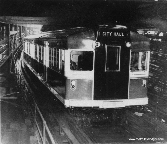 "This is one of the experimental ""Bluebird"" articulated compartment car trains (probably the prototype) being tested on the Brooklyn-Manhattan Transit system circa 1939. BMT ordered 50 of these units from the Clark Equipment Company, intended to be ""fast locals"" to mix with slower express trains on El lines. But when the City of New York purchased BMT in 1940, they cancelled the order, except for five units that had already been built. They lived out the rest of their days as oddball equipment before being scrapped in 1956. But the Bluebirds were the first rapid transit cars to use PCC technology, and were a major influence on the four articulated 5000s that CRT ordered at the end of World War II."