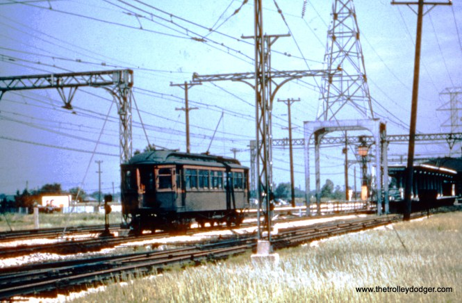 "A single CRT wooden ""L"" car is at the Dempster Street terminal in Skokie, probably in the 1940s. This ""L"" branch was replaced by buses in 1948, but returned in 1964 in the form of the Skokie Swift (today's Yellow Line), a year after the North Shore Line (who owned these tracks) ended all service."