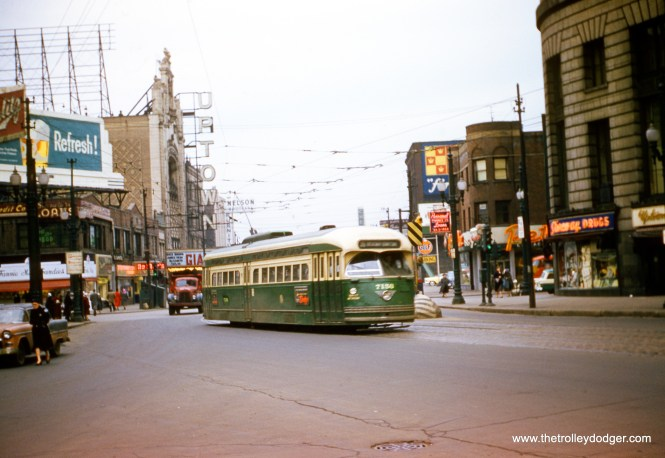 CTA 7156 heads south on Broadway at Lawrence in Uptown on February 15, 1957, the last day of streetcar service on Broadway. The film Giant, starring James Dean, Rock Hudson, and Elizabeth Taylor, opened in the US on November 24, 1956, and was playing at the Uptown. You can see the Green Mill lounge a bit south of the Uptown. The Riviera Theater would be just out of view to the left here. A version of this image, taken from a duplicate slide, appears on page 244 of B-146, mistakenly credited to Charles L. Tauscher. (Robert Heinlein Photo)