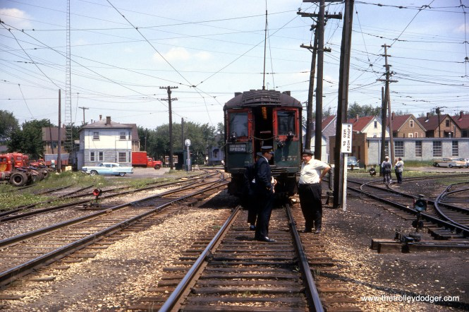 On June 16, 1962, the late Maury Klebolt talks to the North Shore Line train crew during a fantrip at Harrison Street in Milwaukee. This must have been an Illini Railroad Club excursion. There were many such trips during the last year of the interurban's existence. (Richard H. Young Photo)