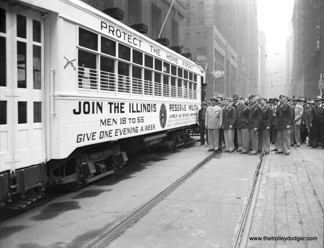 On May 22, 1944, Illinois Governor Dwight H. Green (1897-1958) poses with officials from the Illinois State Militia, next to a 1700-series Chicago Surface Lines car promoting that branch of the military during World War II. Green served two terms as governor from 1941-49 before his defeat by Democrat Adlai Stevenson.