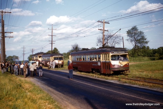 "On June 6, 1954, the National Railway Historical Society held a fantrip to say goodbye to trolley service on the Red Arrow interurban to West Chester, PA. Cars 14, 20, and 68 were used, and after 20 broke down, it was towed by 68. This was a photo stop, and the slide identifies the location as either ""Milltown"" or ""Mill farm,"" the handwriting is hard to make out."