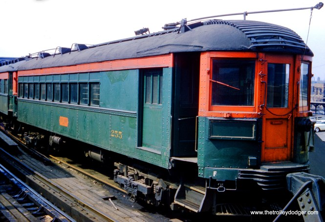 "North Shore Line combine car 255 on June 1, 1962. Note the variations in paint color on this car, ranging from a dark green to a bluish green. That should be enough to drive would-be modelers crazy in their quest for authenticity. Don's Rail Photos: ""255 was built by Jewett in 1917. It had all of the seats removed in the 1920s to provide a full length baggage car which ran in passenger trains. It was used for the Chicago Symphony Orchestra to move equipment to Ravinia. On July 2, 1942, the 40 seats were replaced. Then on December 1, 1946, the seats were again removed. In addition to the Symphony, the car was used for sailors' baggage from Great Lakes."""