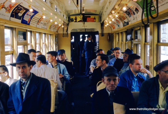 "An interior view of CTA wood car 1813, built by ACF in 1907. This picture was taken on a May 1, 1955 fantrip, while the train was on the Van Buren Street temporary ground level trackage, where the Garfield Park ""L"" ran from 1953 to 1958 during construction of the nearby Congress rapid transit line. (William C. Hoffman Photo)"
