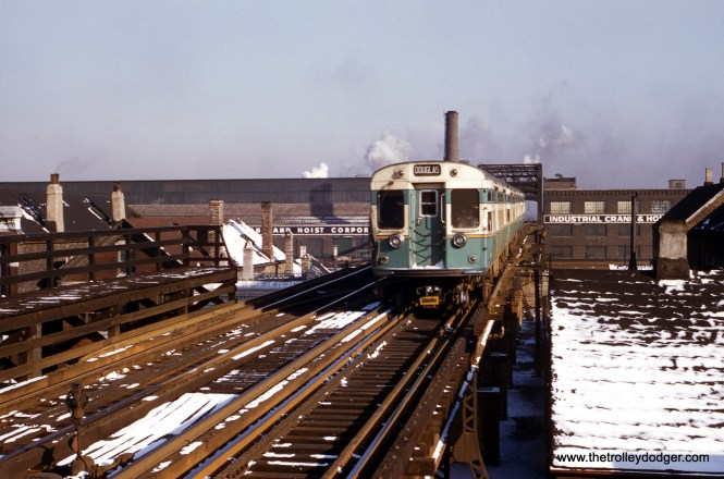 "Here. we see the tail end of a northbound four-car train of CTA 6000s on the Douglas Park ""L"" at 18th Street. The date was March 7, 1955. (William C. Hoffman Photo)"