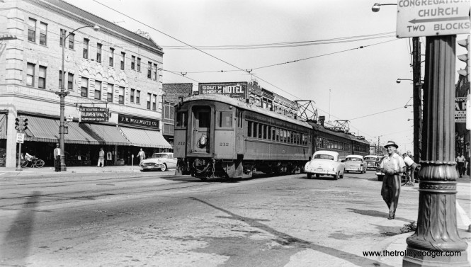 This photo, showing a South Shore Line train running in the street in East Chicago, Indiana, must have been taken just prior to the relocation of these tracks in 1956. Since then, they have run next to the Indiana Toll Road. The location is on Chicago Street at Magoun Avenue, less than a mile east of the Indiana Toll Road. The train appears to be heading east. That's a 1955 or '56 Buick at left across the street.