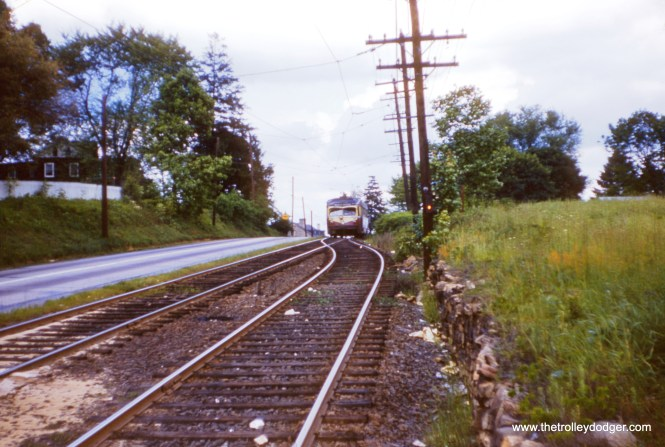 J. W. Vigrass took this photo along the Red Arrow's West Chester line on May 29, 1954, just about a week before buses replaced trolleys. This long side-of-the-road interurban fell victim to a project that widened West Chester Pike.