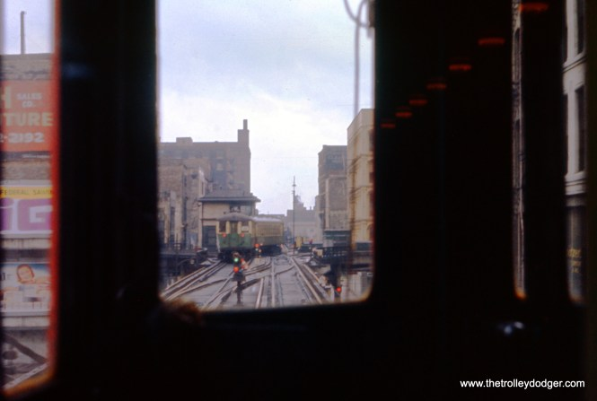 """The view looking west along Lake Street from the front window of a North Shore Line train in July 1960. This was during the period when the Loop """"L"""" ran in one direction, so the train we see near Tower 18 was also heading west. Soon, this North Shore Line train would turn north. (J. W. Vigrass Photo)"""