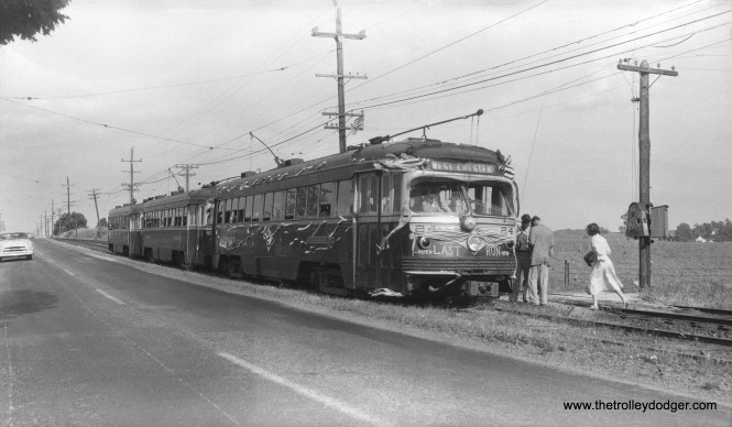 This photo did not come with any information, but it is a fantrip held on the Red Arrow's West Chester trolley line on June 6, 1954, when the line was replaced by buses. We previously posted a color image taken at this photo stop, where the location was given as either Milltown or Mill Farm, the handwriting was difficult to make out. Apparently one of the three cars shown here broke down and had to be towed by one of the others.