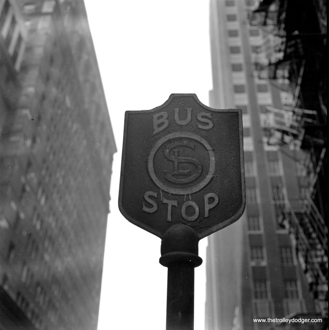 A Chicago Surface Lines bus stop sign in Chicago's Loop on July 18, 1951. Interestingly, the late Jeff Wien had just such a sign in his collection. Not sure if it is an original or a copy, though.