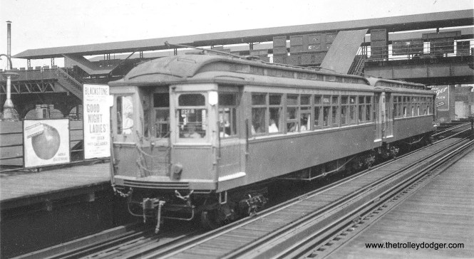 """This is an inspection train at the Lake Street Transfer """"L"""" station, which provided connections between the Lake Street """"L"""", on the lower level, and the Metropolitan above. The higher level station was closed in February 1951, when the Dearborn-Milwaukee subway opened."""