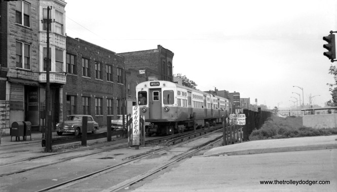 """Around July 1, 1957, a westbound CTA Garfield Park """"L"""" train is westbound on the Van Buren temporary trackage at California Avenue (2800 W.)."""