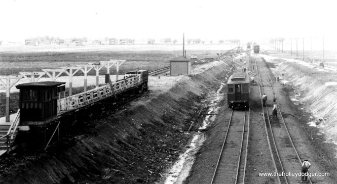 The CRT Westchester branch at Roosevelt Road, circa 1929-1930. Service along this line opened in 1926, and when the line was extended, local officials insisted that tracks not cross Roosevelt at grade, thereby necessitating this grade separation project. The platform at left was later moved into the open cut, although the original station house was retained. Service to Mannheim began in 1930. The line was abandoned in 1951. We are looking north. (George Trapp Collection)