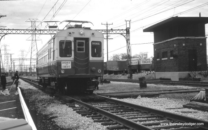 """The Skokie Swift on April 20, 1964.  Note the old tower at right near Dempster, which had been used when """"L"""" service ran on the Niles Center branch here from 1925-48.  This tower remained standing for many years."""